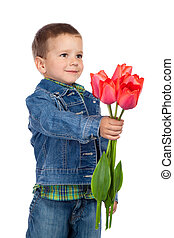 Little boyl with red tulips