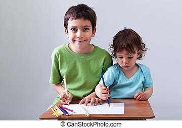 Little boys drawing together