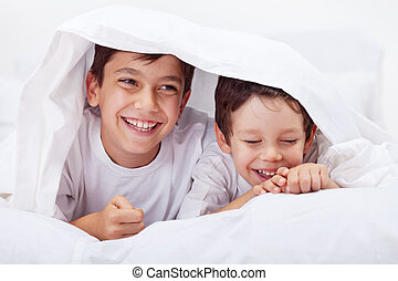 Little boys giggling together