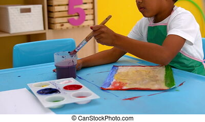 Little boys painting at table - Cute little boys painting at...
