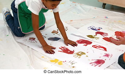 Little boys painting with hands
