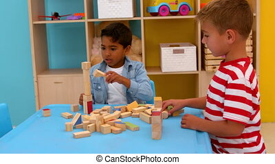 Little boys playing with blocks