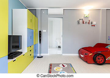 Little boy's room with a car shaped bed - Designer and...