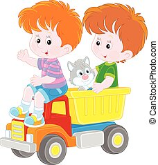 Little boys with a toy truck