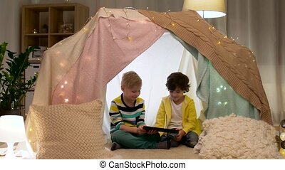 little boys with tablet pc in kids tent at home - childhood,...
