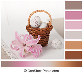 Little Braided Wooden Basket With Chocolate Eggs On Handmade Natural Linen Napkin. Hyacinth Flowers. Palette With Complimentary Colour Swatches