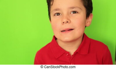 Child making funny faces at camera