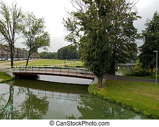 Little Bridge in Kralingen lake - Distant view of a Little...