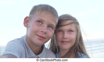 Little brother and sister making self-portrait photographs