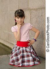 Little brunette girl outdoors