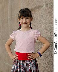 Little brunette girl smiling