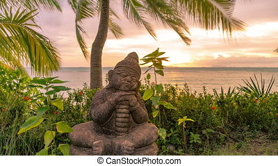 Little Buddha statue beside the sea at the sunset time in Koh Samui, Thailand. Timelapse 4K.