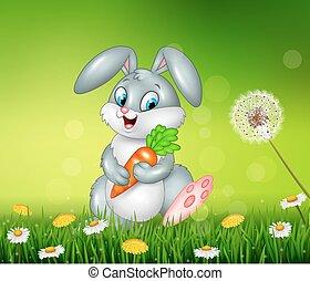 Little bunny holding carrot