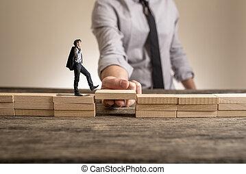 Little businessman walking across bridge, while the hand of...