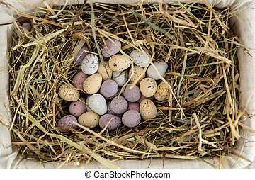 Little candy easter eggs in a basket