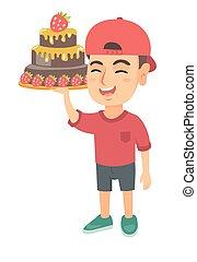 Little caucasian boy holding a chocolate cake.