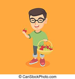 Little caucasian boy holding basket with apples.