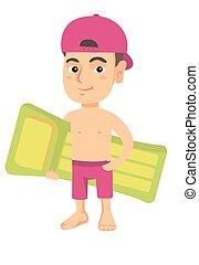 Little caucasian boy holding inflatable mattress.