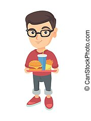 Little caucasian boy holding tray with fast food.