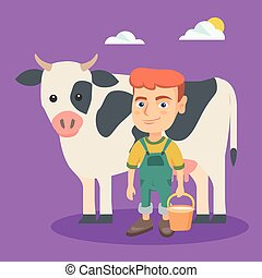 Little caucasian farmer boy milking a cow.