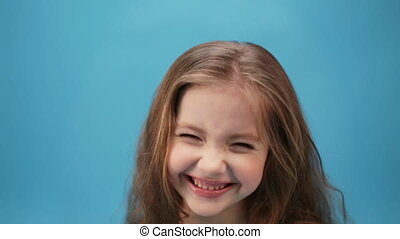 little cheerful girl laught