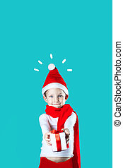 little cheerful Santa gives a gift on mint background