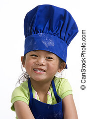 Little Chefs 019 - A young girl having fun in the kitchen ...