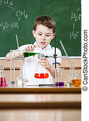 Little chemist conducts an experiment - Little chemist holds...