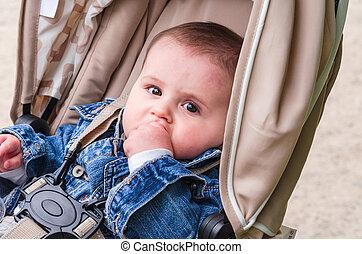 Little child baby in a pram