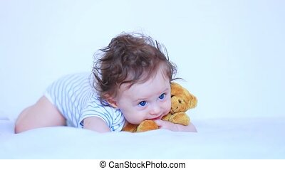 Little child boy with blue eyes and teddy bear
