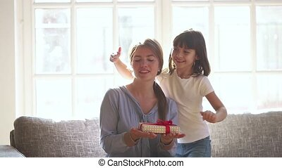 Little child daughter congratulate happy mum with mothers...