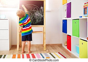 little child drawing on the blackboard