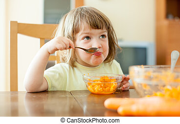 child eating carrot salad - Little child eating carrot salad...