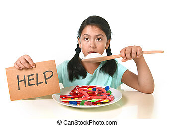 little child eating sweet sugar in candy dish holding sugar spoon asking for help in unhealthy nutrition concept