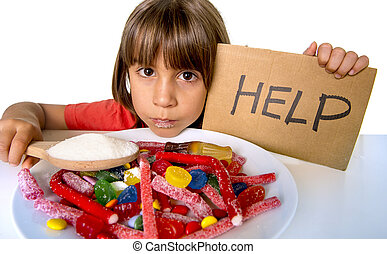 little child eating sweet sugar in candy dish holding sugar spoon unhealthy diet concept