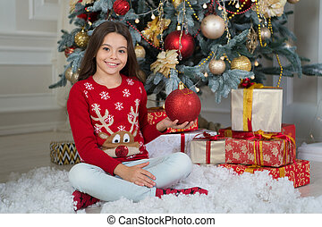little child girl likes xmas present. Christmas. Kid enjoy the holiday. Happy new year. small happy girl at christmas. The morning before Xmas. New year holiday. Beat the Christmas rush