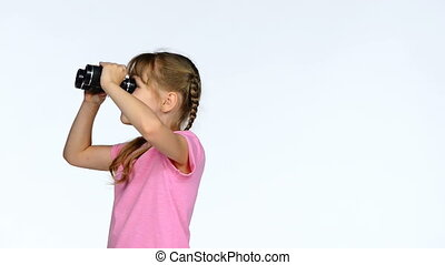 Little child girl looking through binoculars