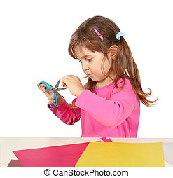 Little Child Girl Making a Cutout