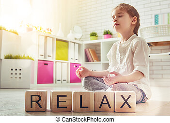 Girl is practicing yoga - Little child girl playing with...