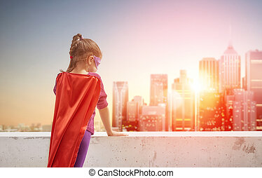 girl plays superhero - Little child girl plays superhero....