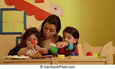 Little child, girl, teacher, school