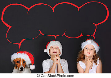 Little child in Sante hat, dreaming of the magic Christmas gifts on snow background.