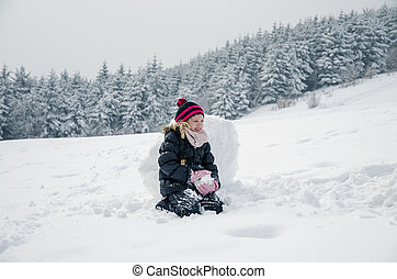 little child in snowy winter time