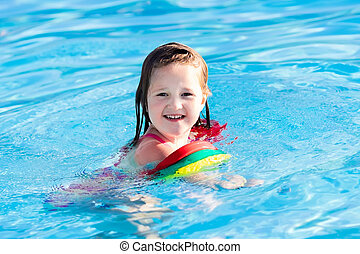 Little child in swimming pool - Happy laughing little girl...