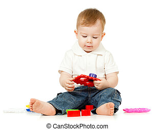 little child is playing with toys