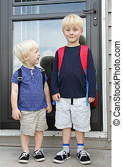 Little Child Looking Up to Big Brother on First Day of School