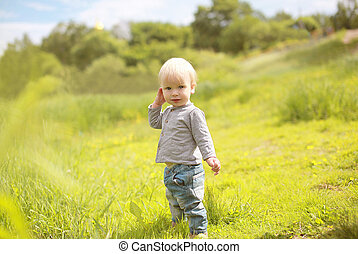 Little child outdoors in summer day