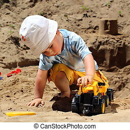 Little child play with sand