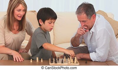 Little child playing chess