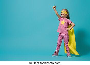 child playing superhero - Little child playing superhero. ...